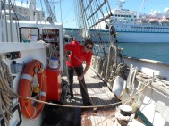 Scrubbing the decks of the Lord Nelson.
